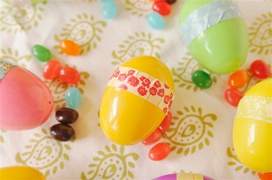 overhead shot of plastic easter eggs and jelly beans