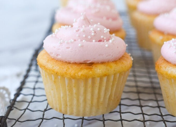 pink lemonade cupcakes on a cooling rack