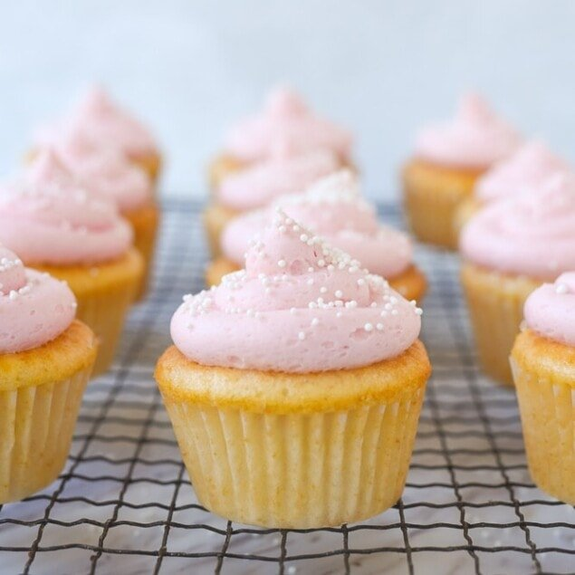 pink frosted cupcake on a rack