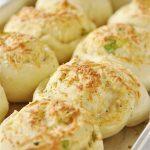 cheese garlic rolls on a baking sheet
