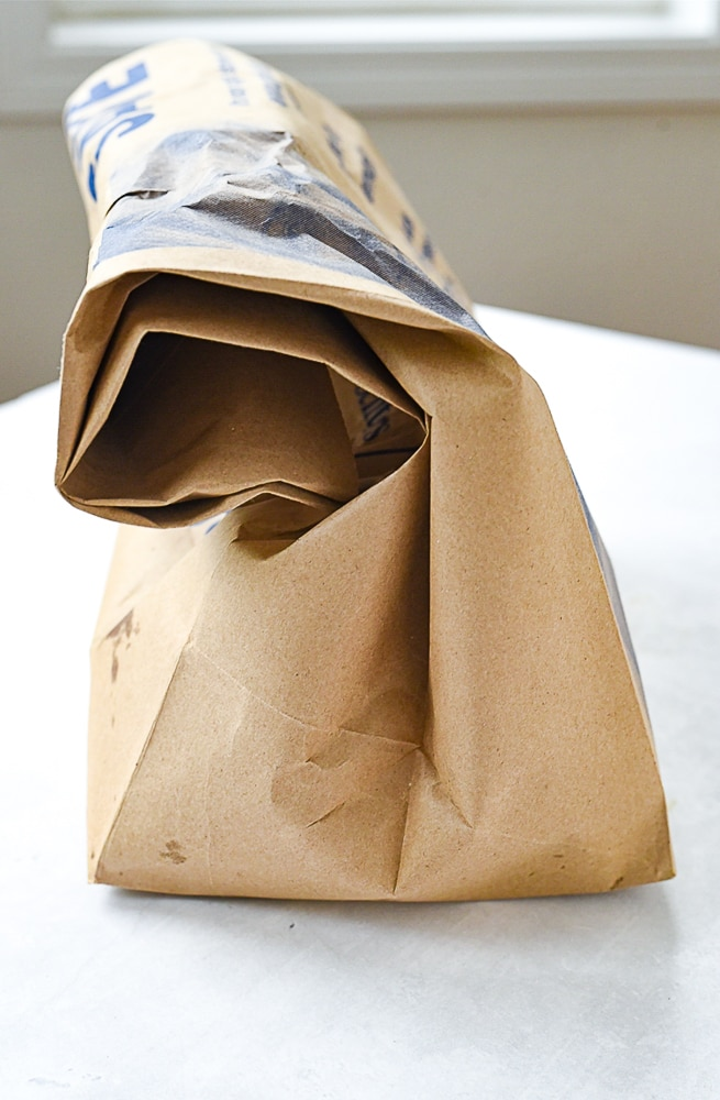 paper bag with roasted red peppers inside