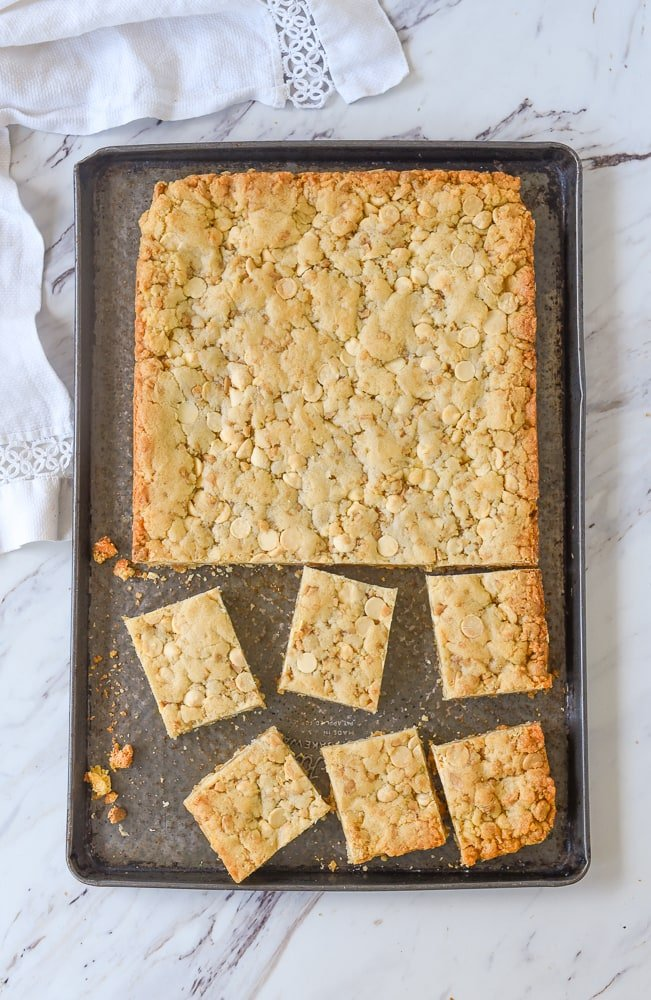 cut squares of blondies on a baking sheet