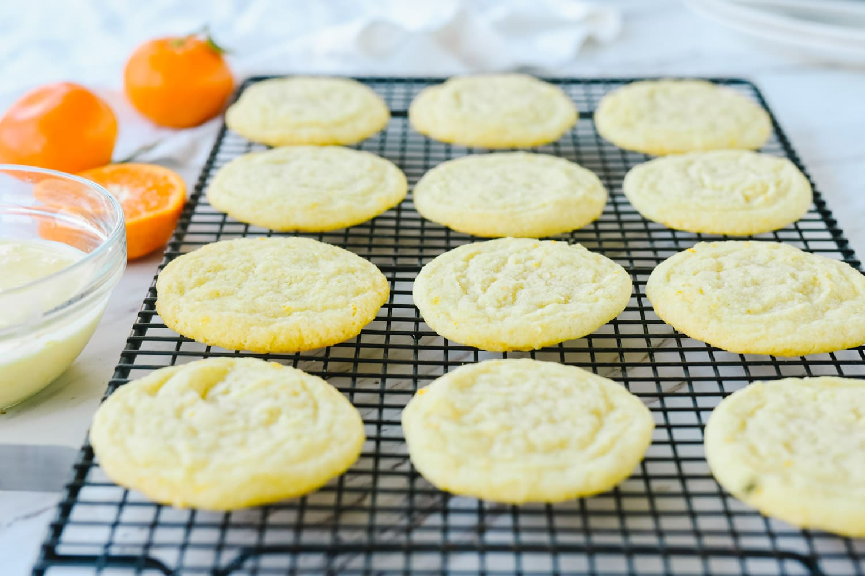 orange cookies on a cooling rack