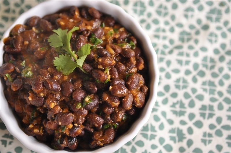 bowl of homemade Cafe Rio Black Beans garnished with cilantro