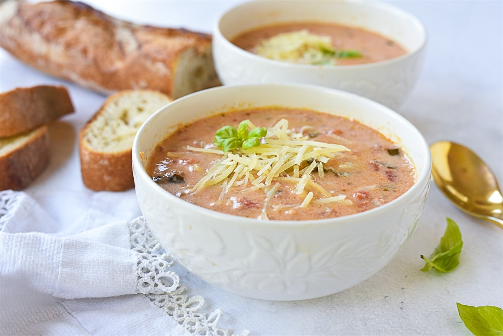 two bowls of tomato basil soup