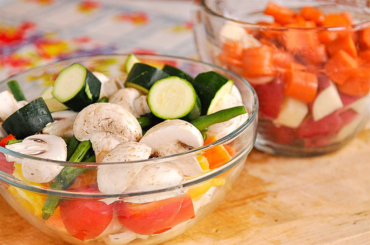 bowls of sliced vegetables
