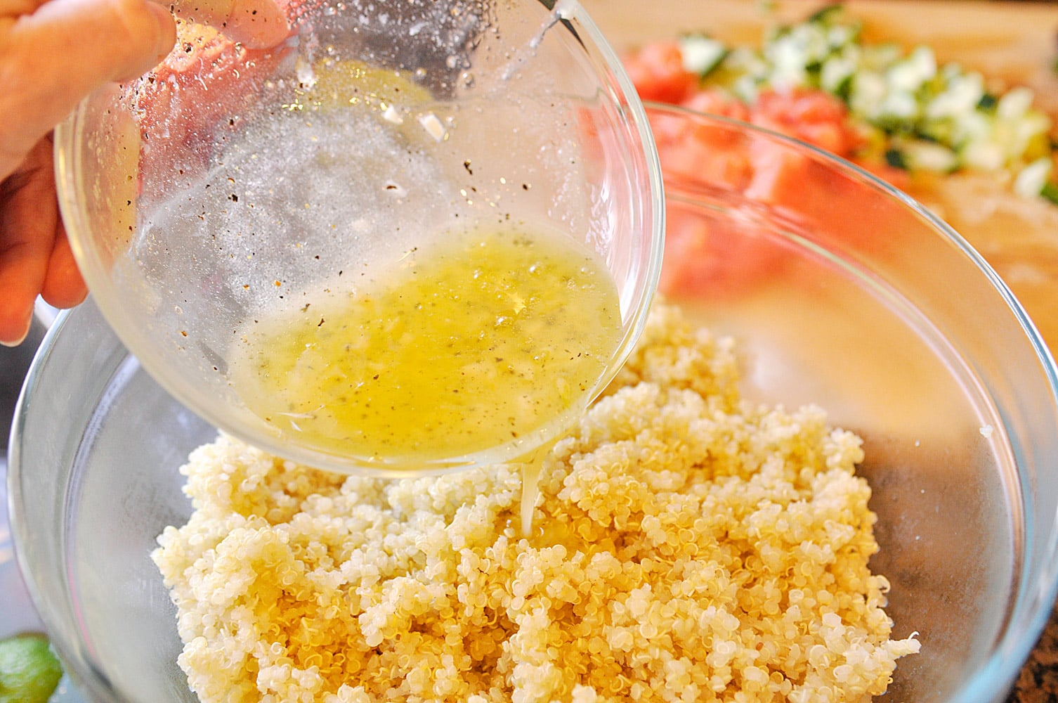 pouring liquid into quinoa