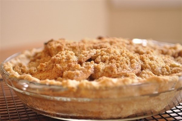 side view of an french apple crumb pie