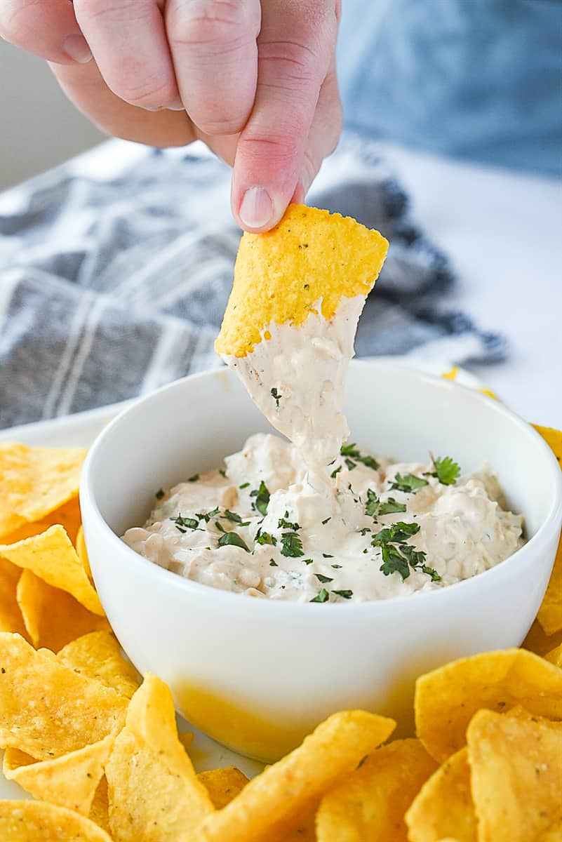 chip dipping into chipotle dip