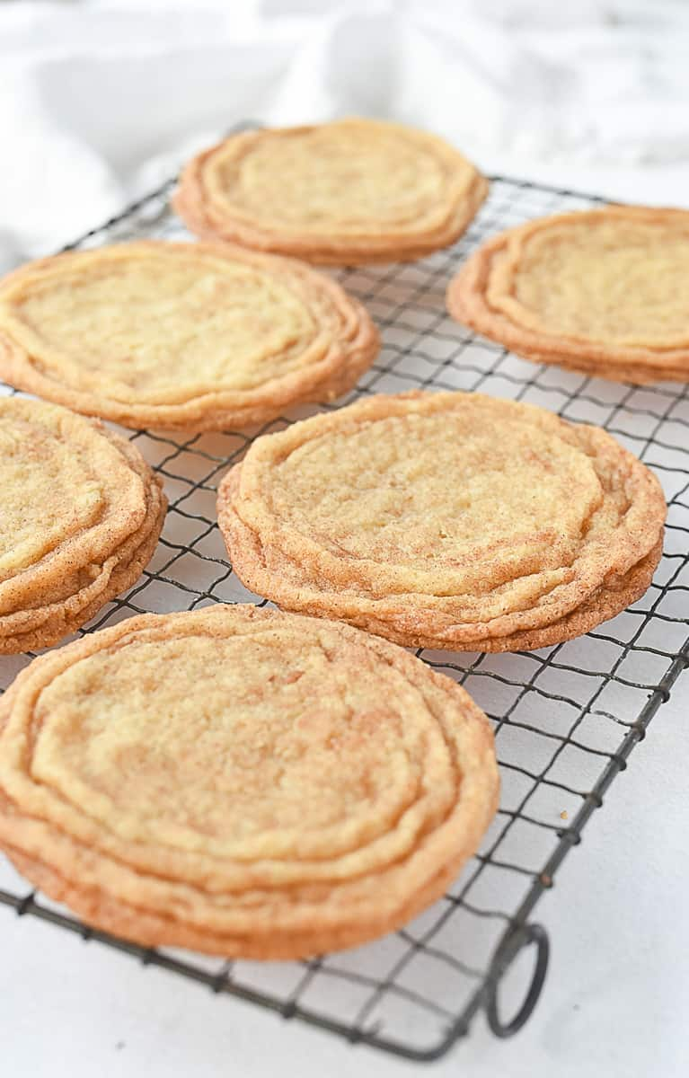 snickerdoodle cookies cooling on rack