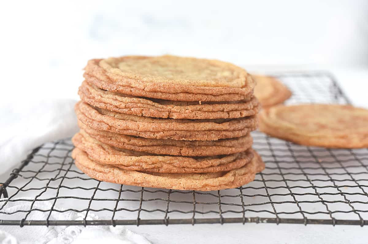 stack of snickerdoodle cookies on a cooling rack