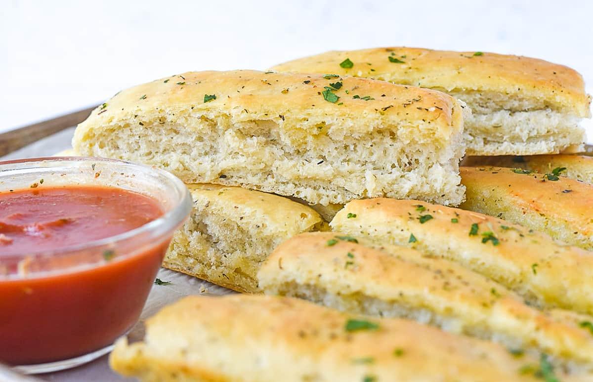 pile of italian breadsticks on baking sheet