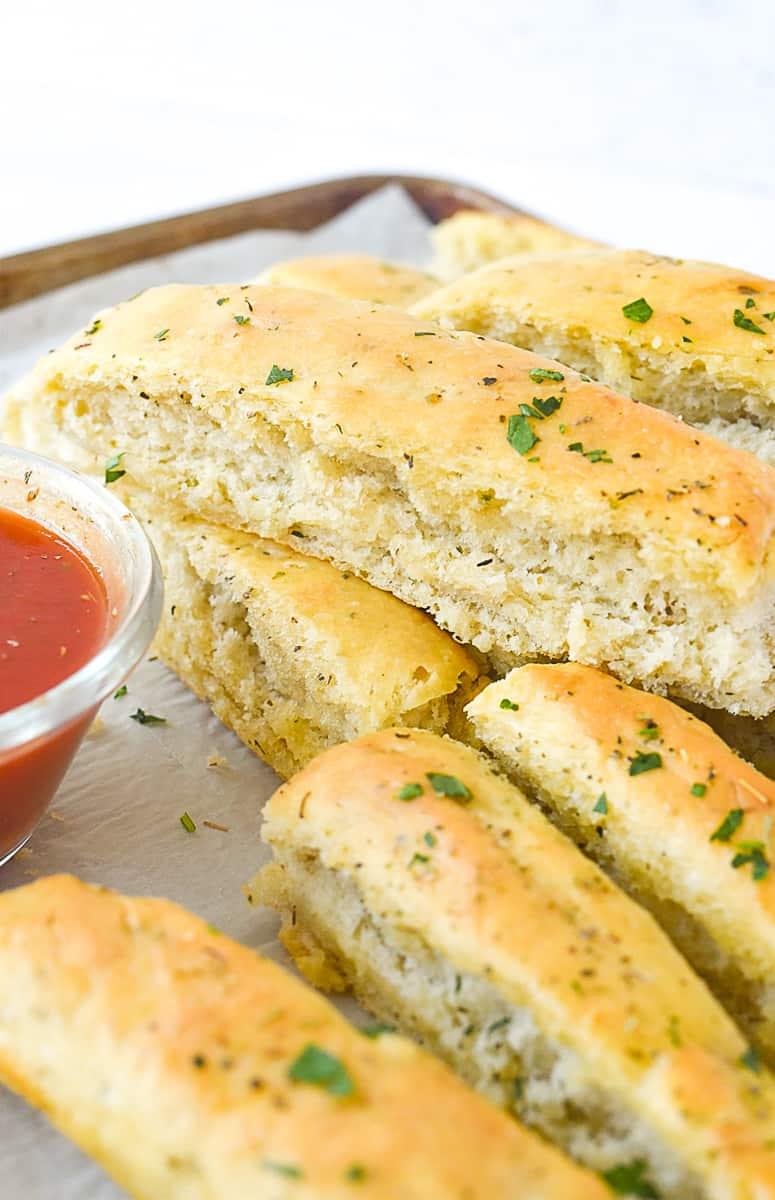 italian breadsticks on a baking sheet