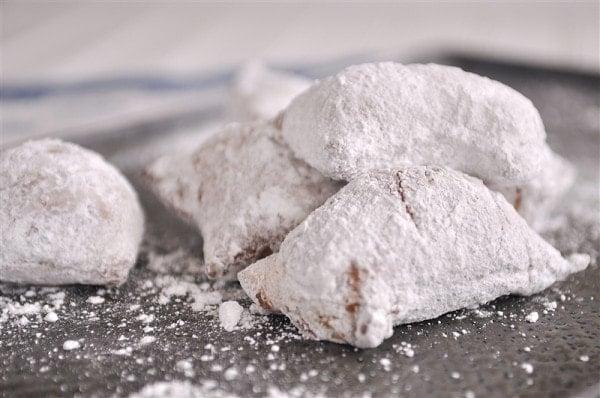pan of powdered sugar beignets