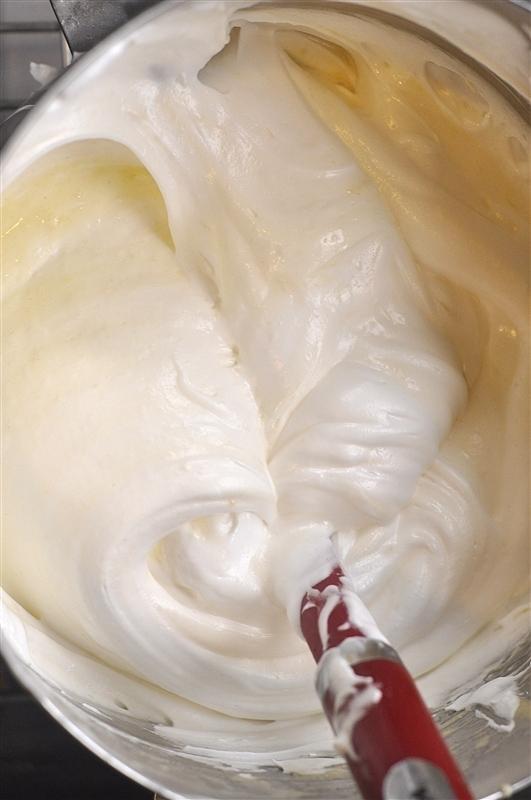folding egg whites into lemon cake batter