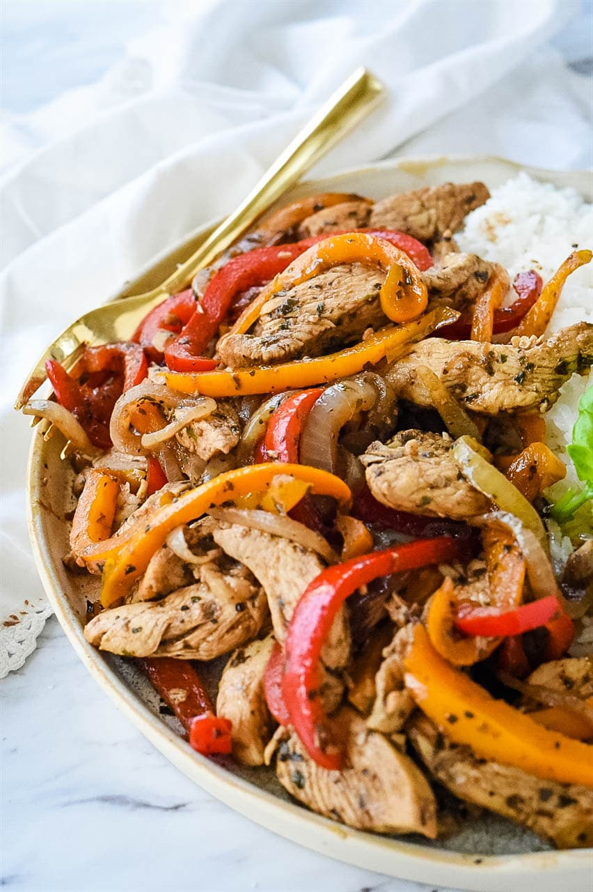 chicken and peppers in a bowl