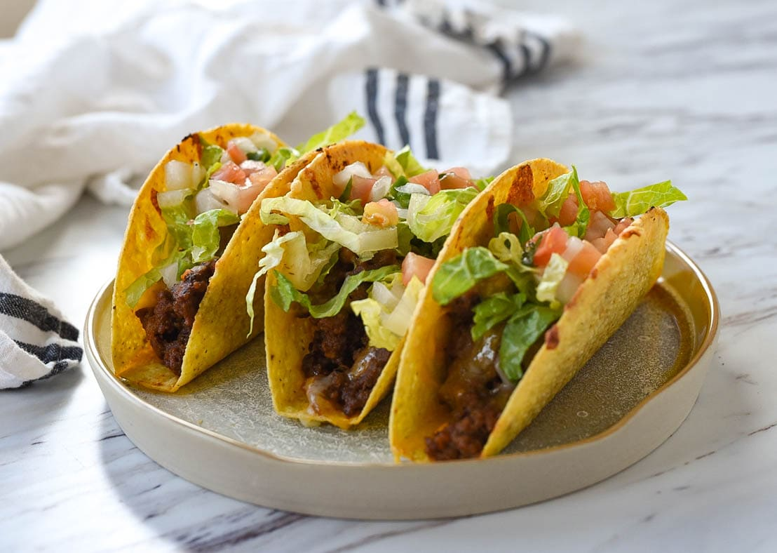 three baked tacos on a plate