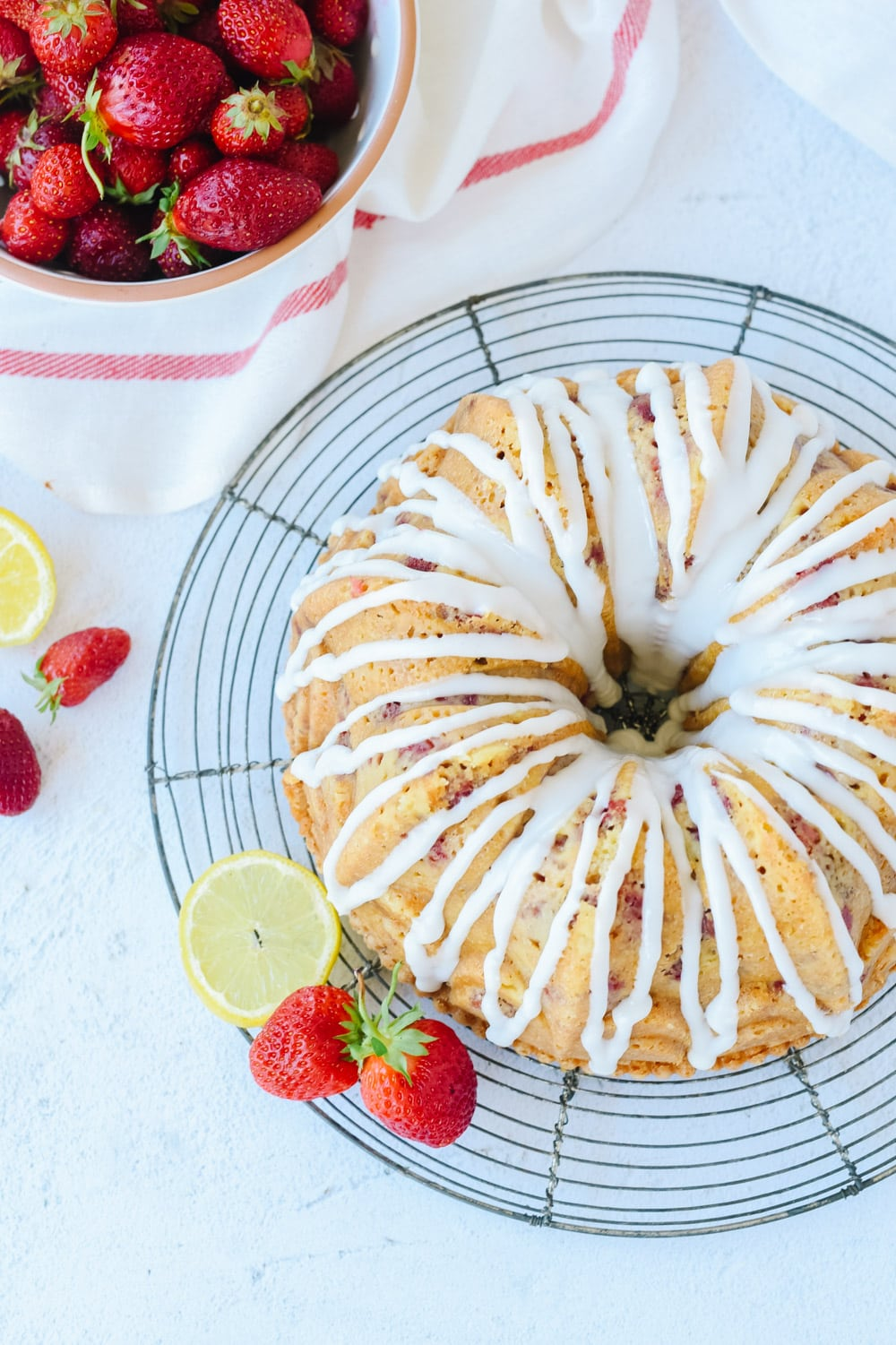Strawberry Sour Cream Cake on a cooling rack