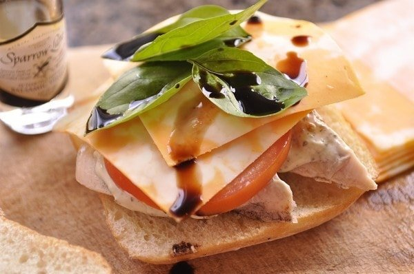 Chicken Caprese Sandwich drizzled with balsamic vinegar