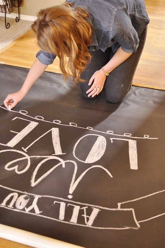 writing with chalk on backdrop