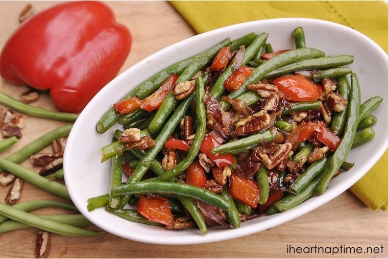 bowl of green beans with red peppers and pecans