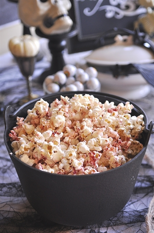 bloody popcorn in a black cauldron halloween party food