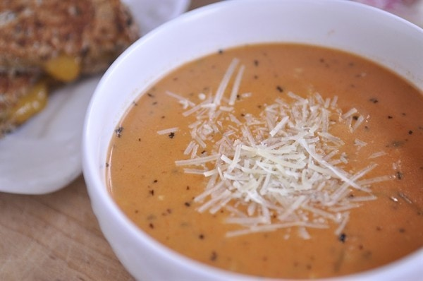 easy tomato soup topped with parmesan cheese