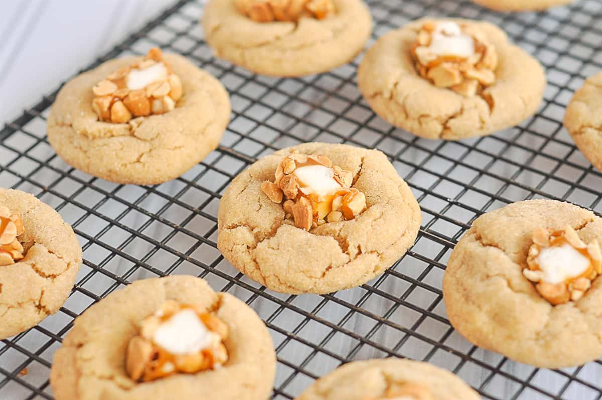 overhead shot of peanut butter blossom cookies on a rack