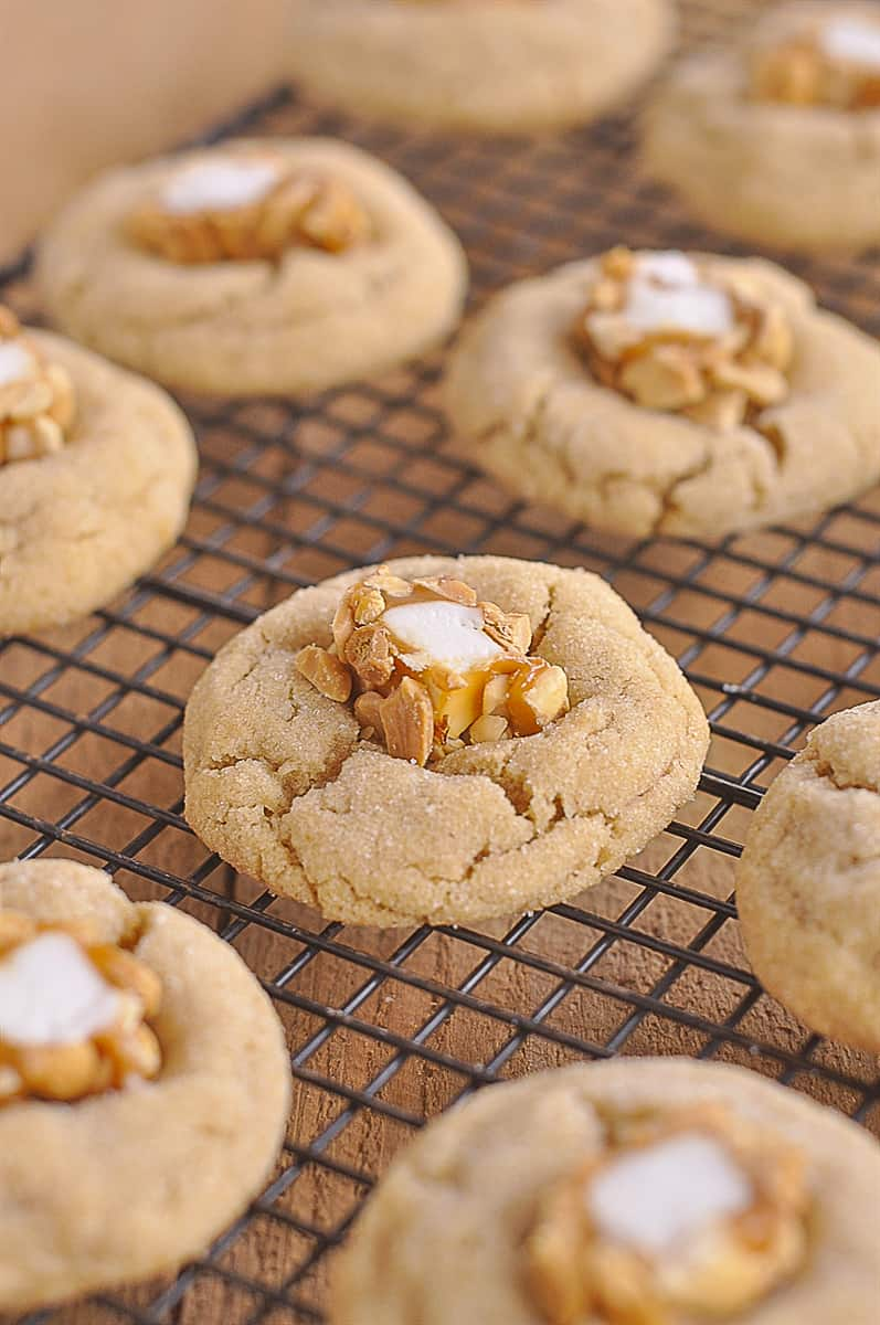peanut butter blossom cookies on a cooking rack