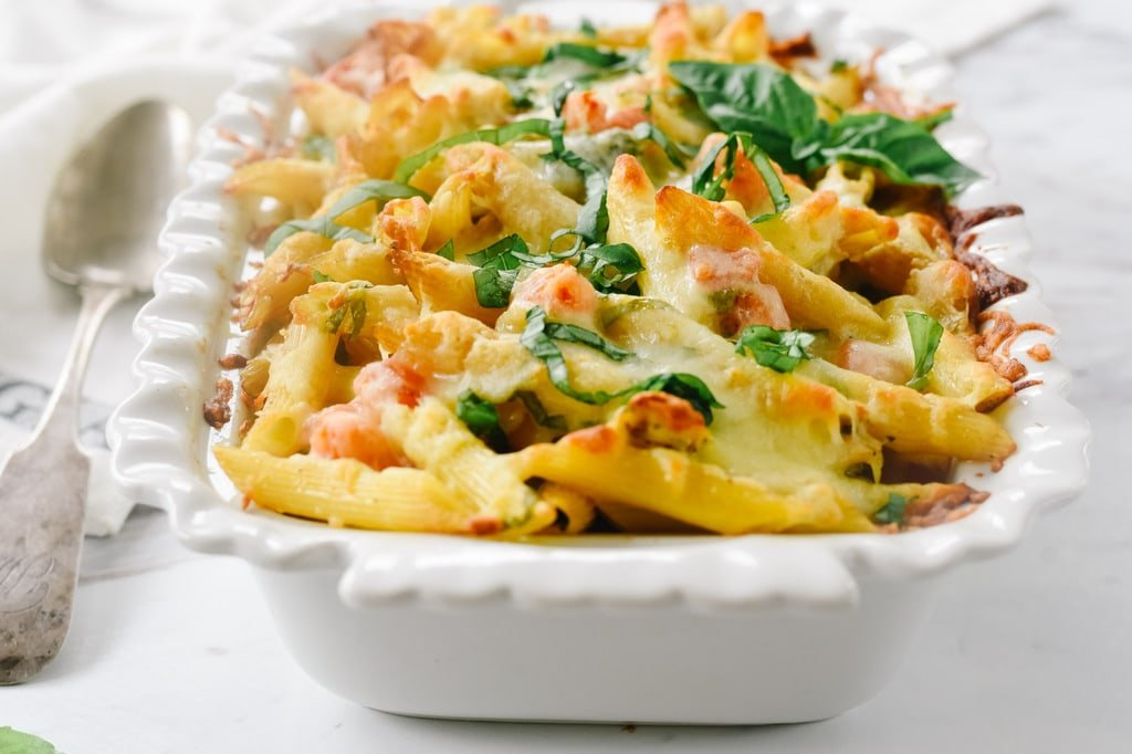 Pesto Chicken Pasta bake in a white casserole