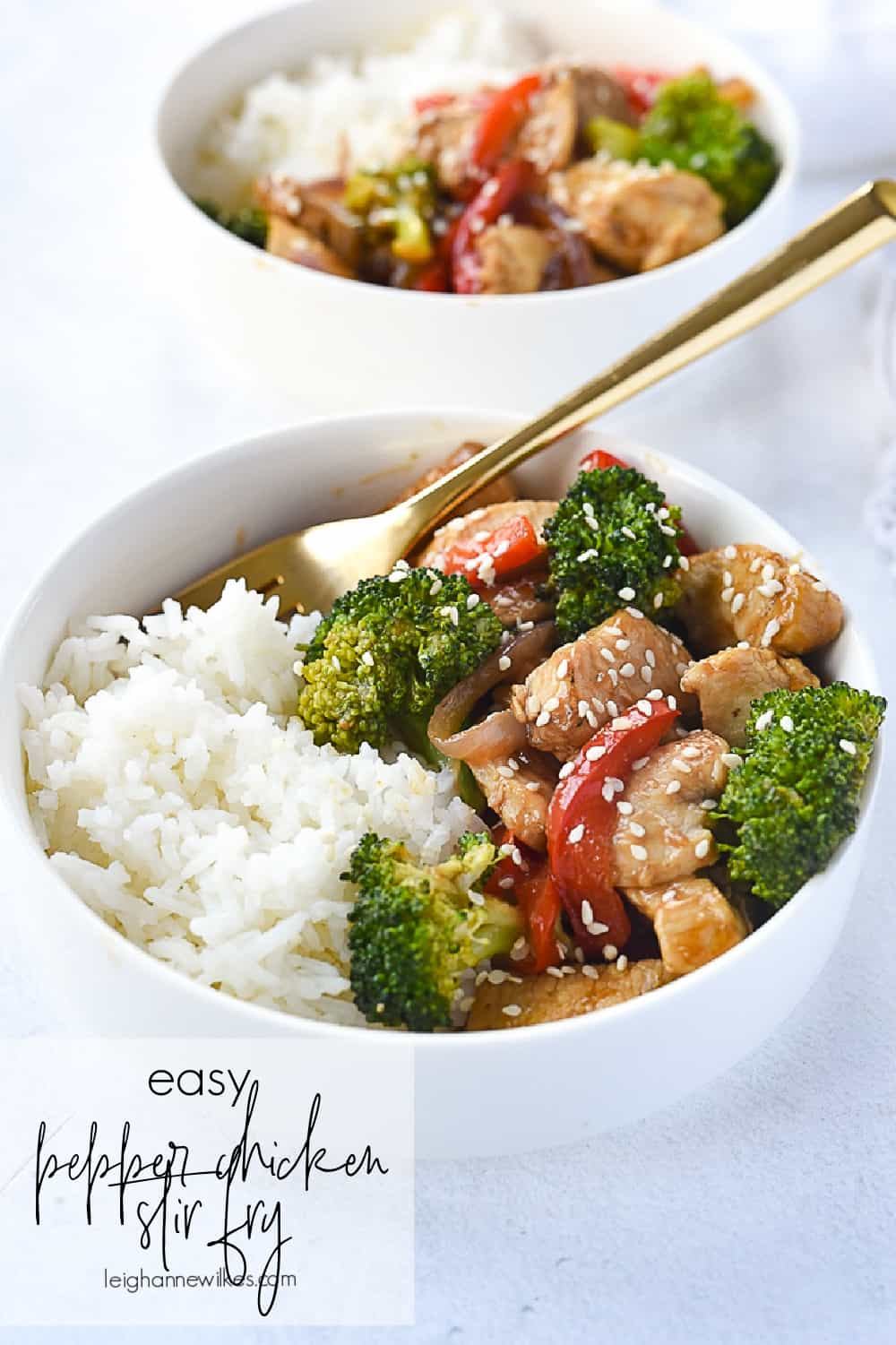 bowl of pepper chicken over rice