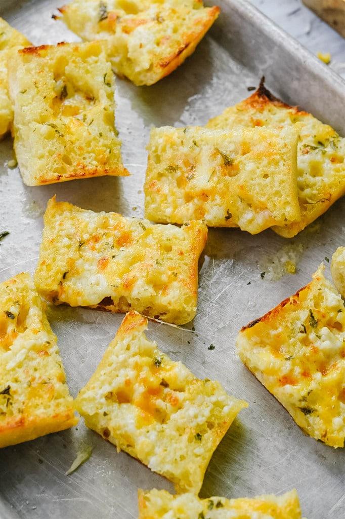 garlic cheese bread on a baking sheet