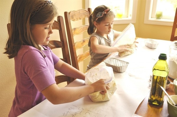 kids making bread in a bag