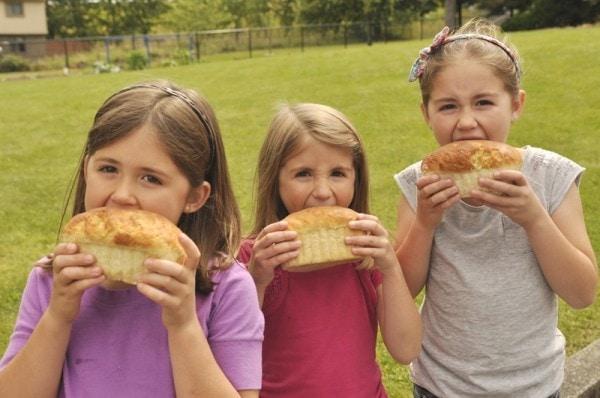 kids enjoying a loaf of bread
