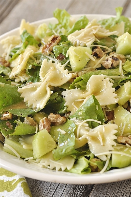 Caesar salad with walnuts and pasta