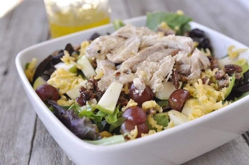 salad with chicken, apples, and pecans