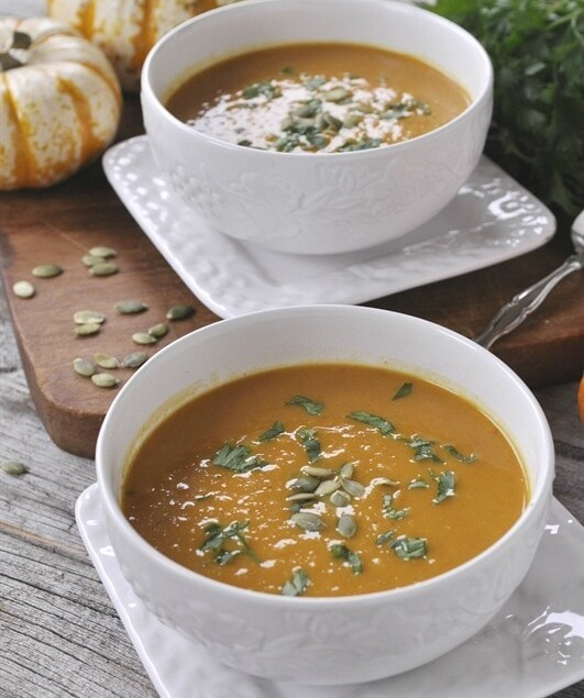 two bowls of pumpkin curry soup