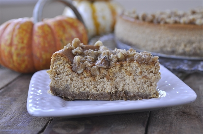 slice of pumpkin cheesecake topped with walnut streusel