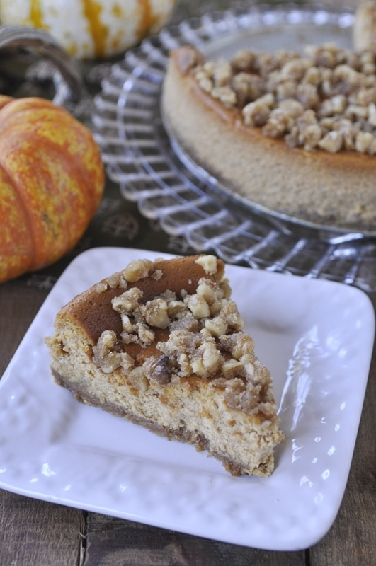 slice of pumpkin cheesecake topped with walnuts