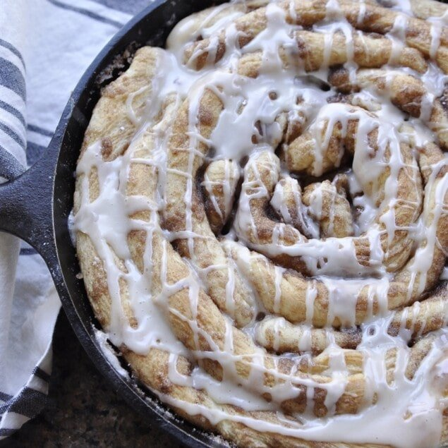 cinnamon roll in cast iron pan