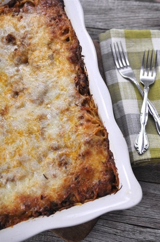 Baked Spaghetti in a white casserole dish
