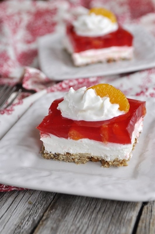 Orange Cranberry Pretzel Salad served on white plates