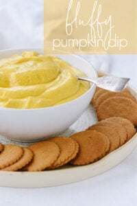 Pumpkin dip in a bowl with cookies