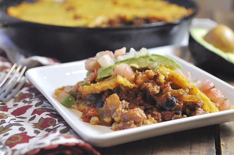 tamale pie casserole topped with avacado