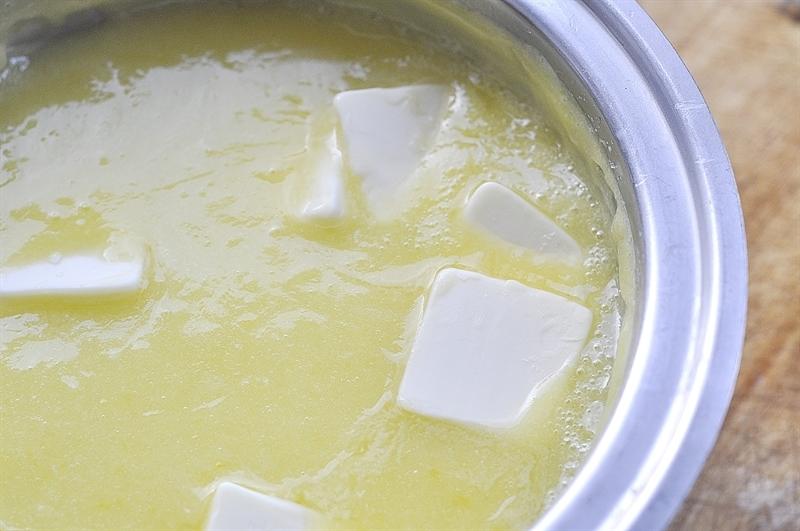 lemon juice sugar and butter in a pan to make lemon curd