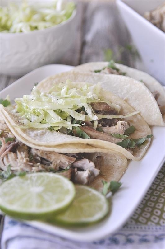 salsa verde pork carnitas tacos with lime