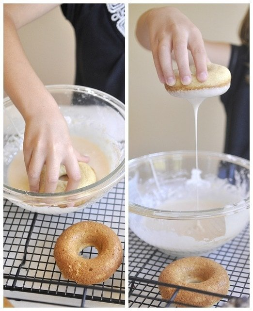 Dipping Baked Donuts into glaze