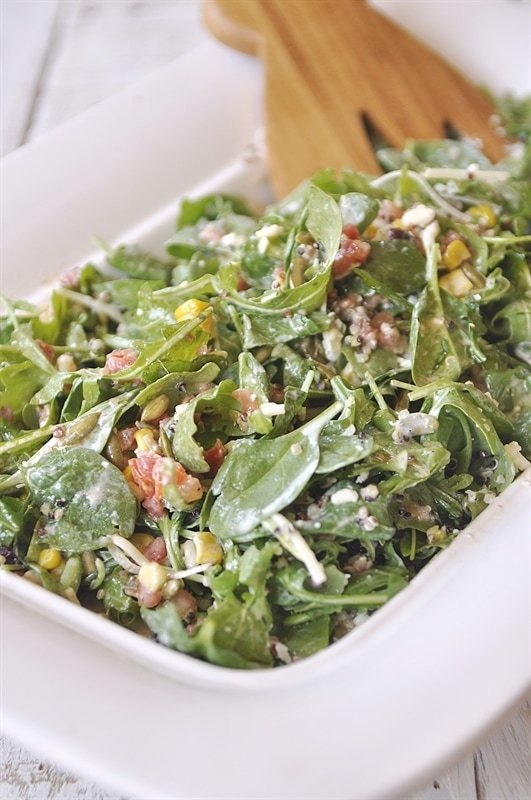After it is layered all pretty in your serving dish, grab your salad dressing.