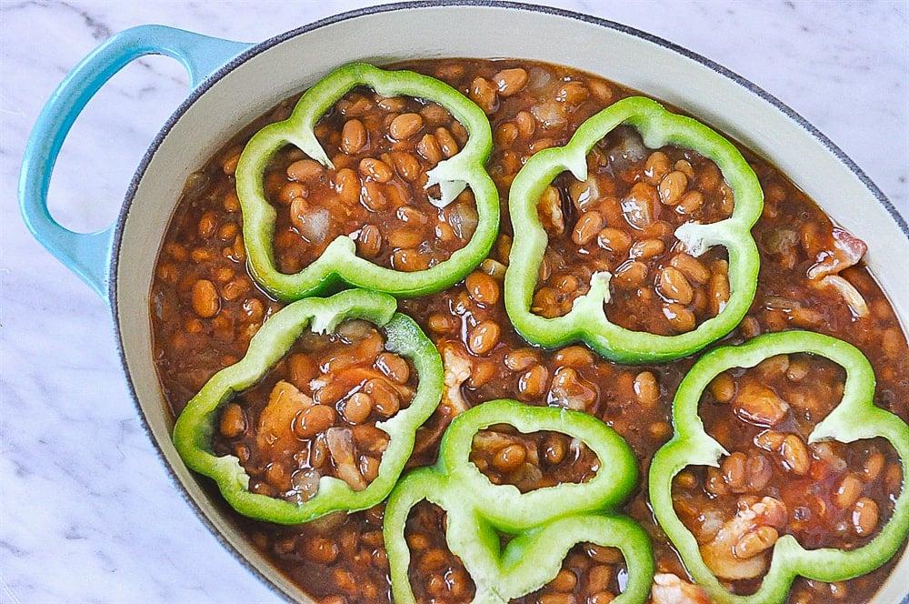 green pepper rings on top of baked beans