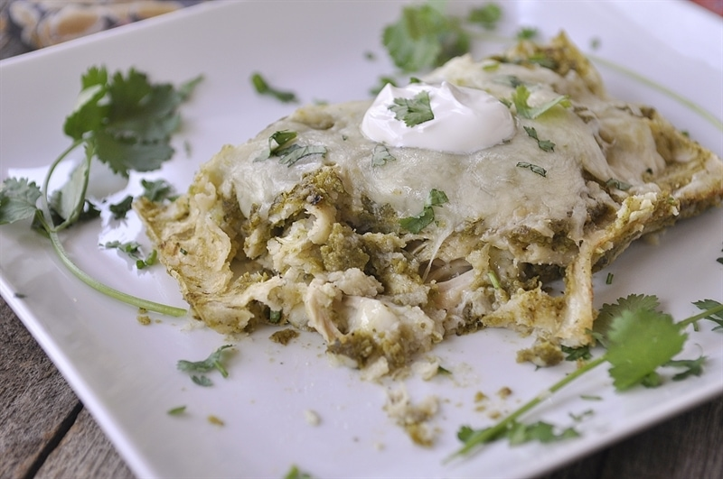 Chile Verde Enchiladas topped with sour cream and cilantro